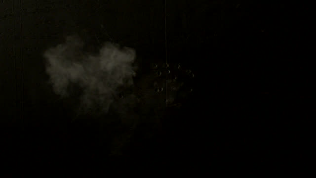 close angle of smoke and sparks. - sparks stock videos & royalty-free footage