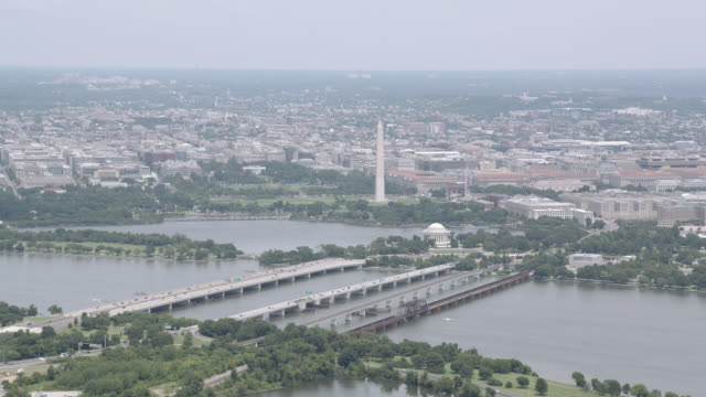 aerial of washington monument and jefferson memorial. potomac river and tidal basin visible. - jefferson memorial stock videos and b-roll footage
