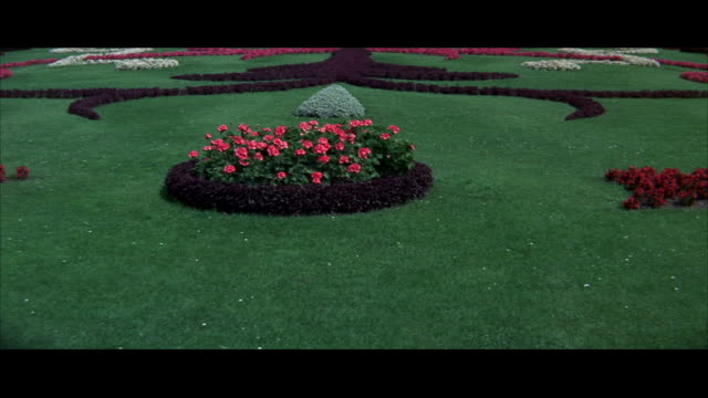 SHOOTING OVER BEAUTIFUL LANDSCAPED GARDEN TO SCHOENBRUNN PALACE.  BEHIND THE SCENES.