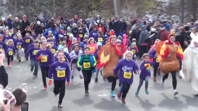 hundreds of children run 100 yards in festive and fun event - salmini stock videos and b-roll footage