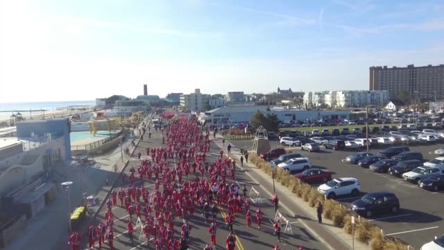 running race with all in santa costumes running race to start holiday season - salmini stock videos and b-roll footage