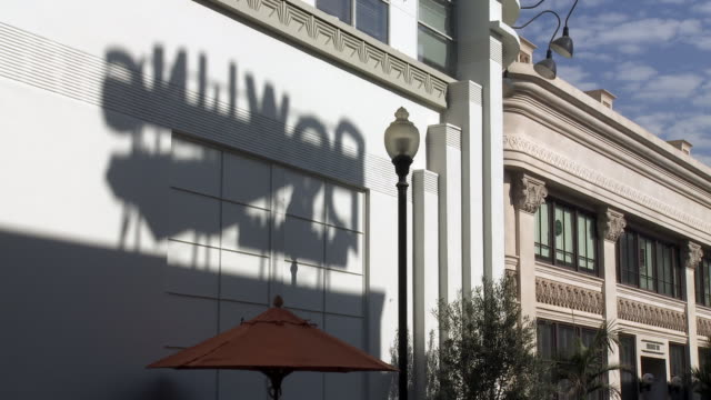 wide angle of shadow of bowling sign on side of building. sony pictures studio lot. los angeles area. - culver city stock videos & royalty-free footage