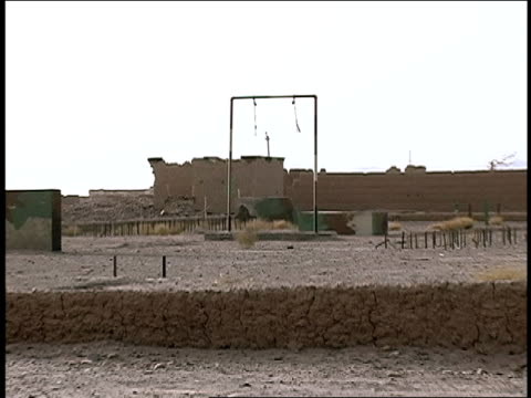 august 2004 medium shot barrels abandoned in deserted alqaida military training camp/ afghanistan - military training stock videos & royalty-free footage