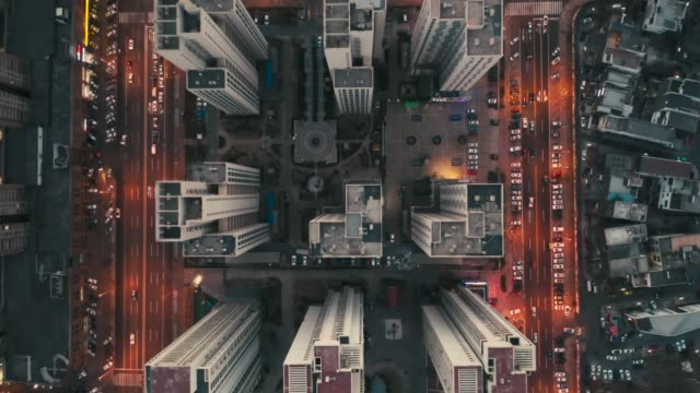 overhead aerial flight over rooftops, urban landscape - panning stock videos & royalty-free footage