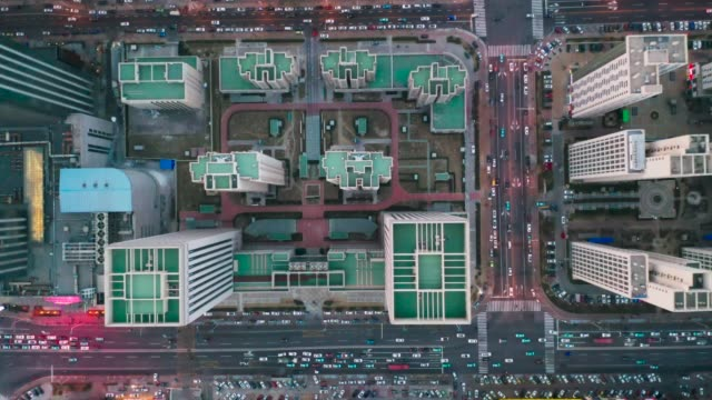 overhead aerial flight over rooftops, urban landscape - housing development stock videos & royalty-free footage