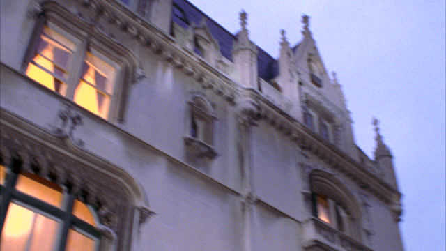UP ANGLE OF MULTI-STORY ORNATE FRENCH RENISSANCE BUILDING. COULD BE UPPER CLASS HOUSE OR MANSION OR APARTMENT BUILDING, OR CONVENT. INTERIOR LIGHTS VISIBLE. BUILDING IS UKRAINIAN INSTITUTE OF AMERICA ON 79TH STREET AND FIFTH AVENUE. LIGHT ON MATCH DX 1565