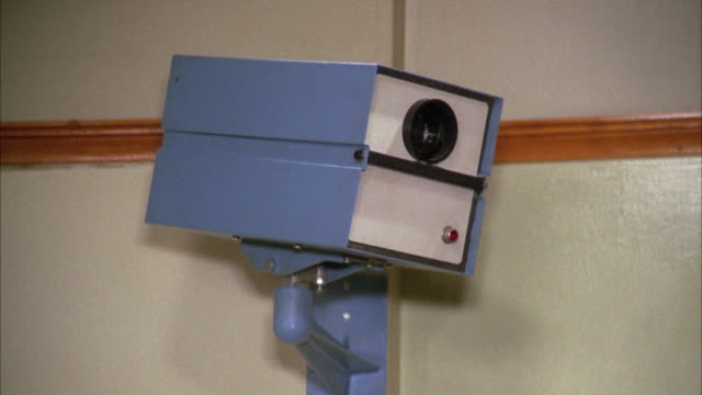 close angle of security or surveillance camera mounted to wall. [shots 1220-04 and 05 match] - 1975 stock videos and b-roll footage