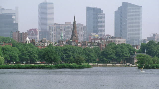wide angle of boston harbor and charles river. boston city skyline in bg. high rises, skyscrapers, and church steeple visible. - river charles stock videos & royalty-free footage