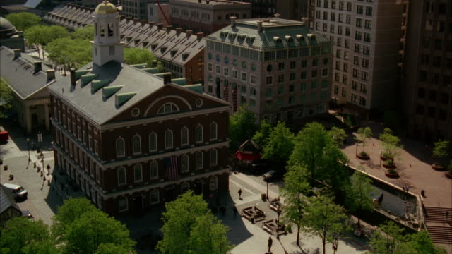 pan up from faneuil hall to custom house clock tower in downtown boston. cities. - custom house tower stock videos & royalty-free footage