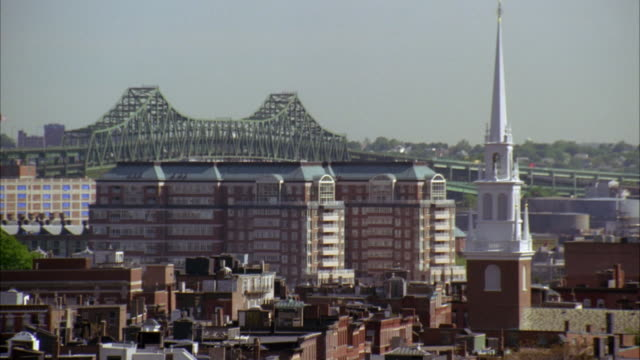 wide angle of urban residential area of boston. steeple of old north church in right fg and maurice j. tobin bridge over  mystic river in bg. - old north church stock videos & royalty-free footage