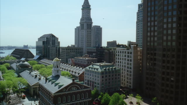 wide angle of dock square in downtown boston. faneuil hall and custom house clock tower. charles river in bg. - custom house tower stock videos & royalty-free footage