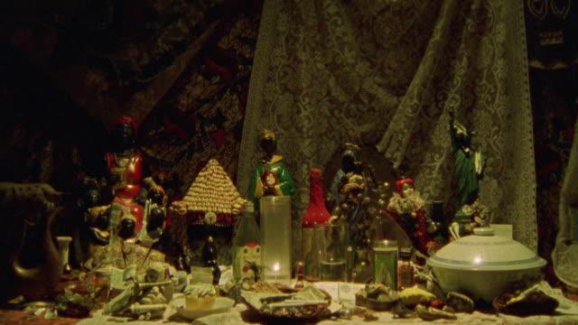 est close angle shot of porcelain clown figure draped in lace. dolls. - anno 2001 video stock e b–roll