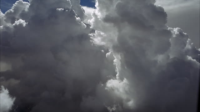 aerial of forward window pov from airplane or jet flying through white cumulus clouds. could be cockpit plate. pov rotates side to side. planes. - cumulus stock videos & royalty-free footage