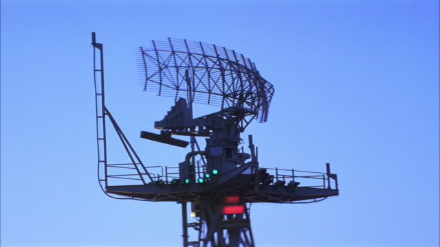 up angle of radar antenna and radar tower of navy aircraft carrier. radar in motion. red avoidance lights on. series. - military ship stock videos and b-roll footage