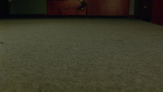 close angle of boom microphone laying on carpeted floor. unseen person picks up recording device and drops back on floor. could also be on movie set. series. - カーペット点の映像素材/bロール