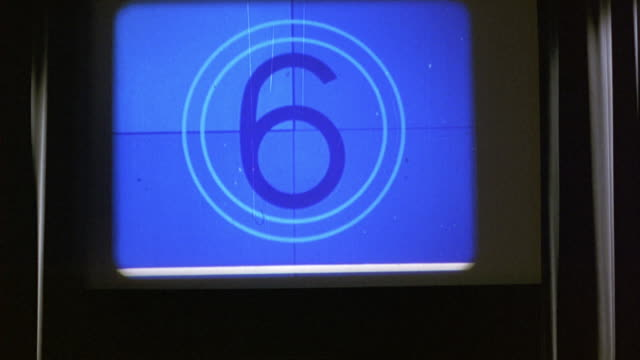 close angle of countdown sequence on head leader of film or movie projected onto screen in movie theater, private screening room or classroom. - projection screen stock videos & royalty-free footage
