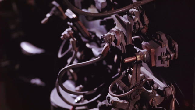 close angle of machinery. bolts and cords attached to metal clamps. presses together. machines. - bolt stock videos & royalty-free footage