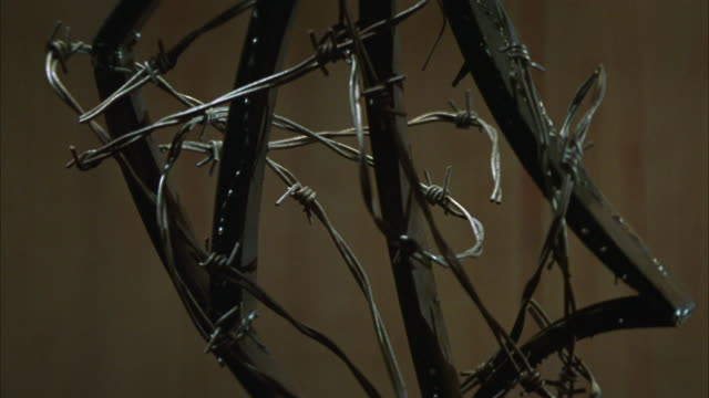 close angle of barbed wire weapon. camera pans around and zooms in on barbed wire weapon. flickering lights. torture.  spear. - torture stock videos & royalty-free footage