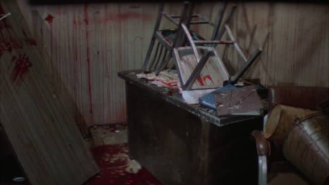 wide angle of bloody and ransacked room. camera pans down to capture blood puddles and splatter. camera pans right to left and  down narrow industrial or electrical building hallway. steadicam shot of hallway with a trail of blood and pans up and down. fl - bloody gore stock videos & royalty-free footage