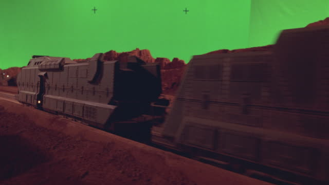 "wide angle of futuristic armored train coming down railroad track. rugged red rock terrain and mountain landscape of mars. martian civilization at hilltop.  monument with plaque reads ""welcome to chryse first city on mars."" train disappears through mounta - railway track stock videos & royalty-free footage"