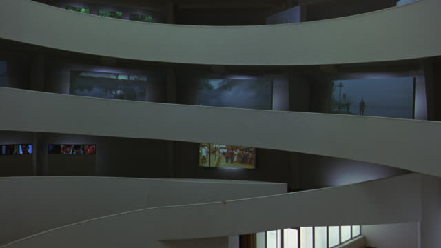 pan left to right of floors or levels in guggenheim museum. frank lloyd wright architecture. digital video art exhibits on walls. atrium and lobby. elevator. - left atrium stock videos & royalty-free footage