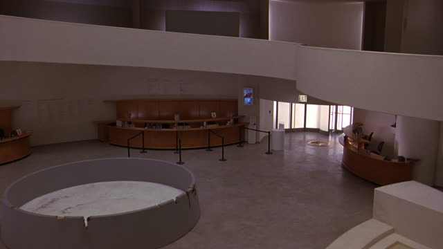 pan right to left of reception area or lobby in guggenheim museum. information desks. floors or levels visible above. frank lloyd wright architecture. atrium. - left atrium stock videos & royalty-free footage