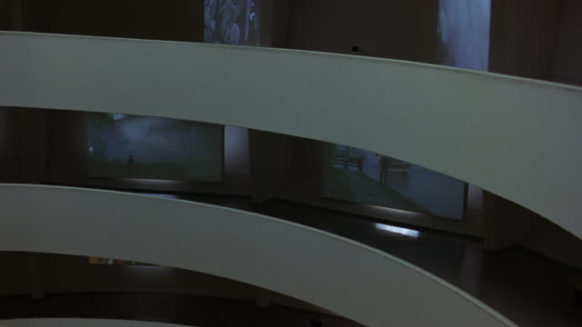 pan left to right of floors or levels of guggenheim museum and then high angle down of lobby. circular art piece in center. information desks. retractable belt stanchions. ramp or incline, walkway. frank lloyd wright architecture. atrium. digital video ar - left atrium stock videos & royalty-free footage