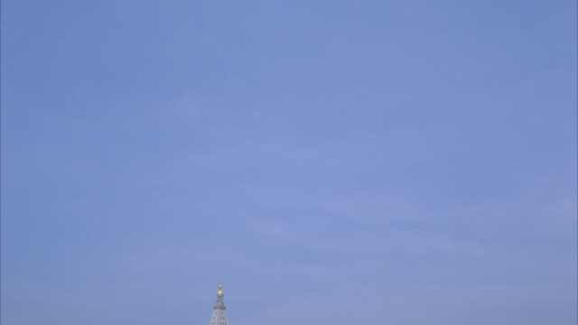 pan right to left of sky. spire of metlife tower or building. clouds. - spire stock videos & royalty-free footage