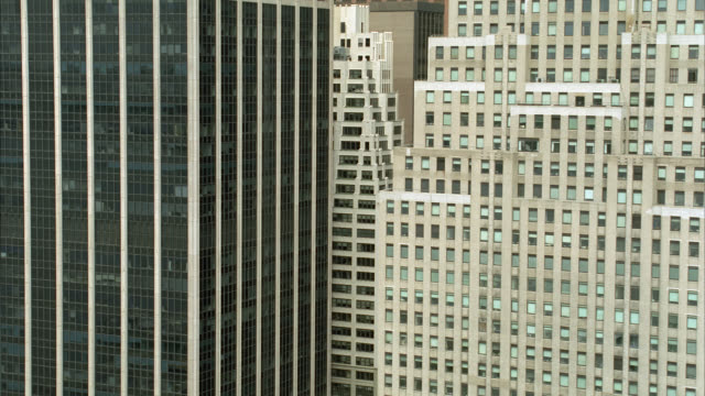 aerial of new york city, downtown manhattan, financial district skyscrapers and high rise office buildings along wall street. citibank building and 120 wall street. glass buildings. - wall street stock-videos und b-roll-filmmaterial