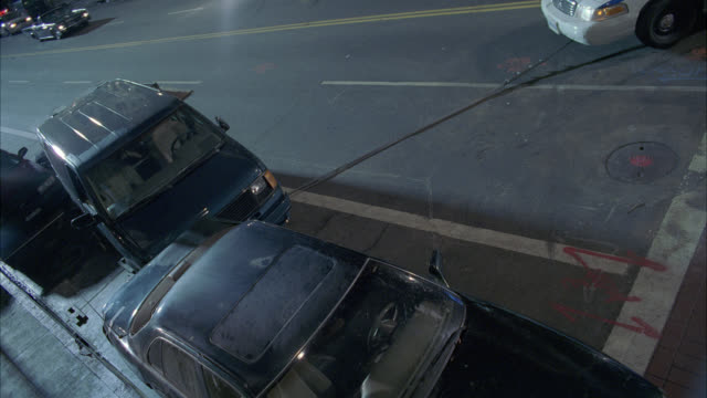 vidéos et rushes de high angle down of nypd police car with flashing lights or bizbar crashing into cars piled up on street. van. debris and glass fly through air. car stunts. - accident de transport