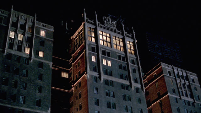 """up angle of high rise brick middle to upper class apartment building. cars parked on city street below. lightning. sign for """"tudor city"""" apartments, east side of manhattan. could be used for penthouse apartment or condominium. - tudor stock videos and b-roll footage"""
