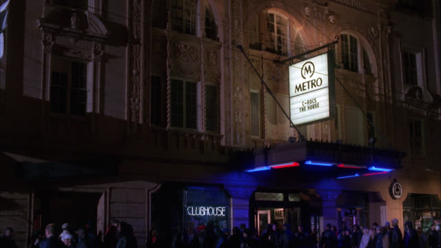 "wide angle of crowds of people in line outside of nightclub. sign reads ""metro"". marquee. could be for concert. could be theater. - theatre banner commercial sign stock videos & royalty-free footage"