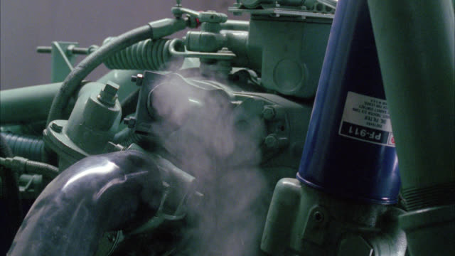 pan down of exhaust fumes coming out of pipe on engine or generator. - generator stock videos & royalty-free footage
