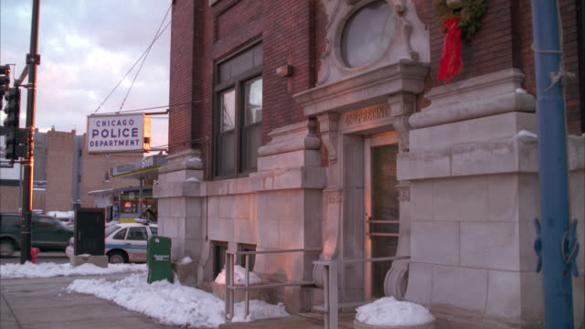 wide angle of police station, department, 42nd precinct. brick building. snow. - police station stock videos & royalty-free footage