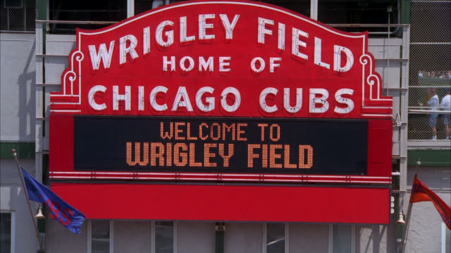 pan down to crowds of people, fans or spectators at wrigley field, baseball stadium, ticket offices. - ticket counter stock videos & royalty-free footage