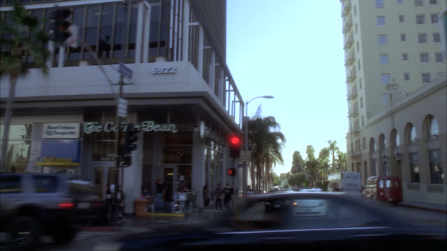 stockvideo's en b-roll-footage met process plate driving straight left of stores, restaurants and shops on hollywood boulevard. cars, people or pedestrians. hollywood walk of fame. landmarks. los angeles area. - hollywood walk of fame