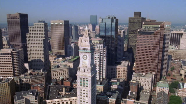 aerial of downtown boston city skyline. custom house clock tower. skyscrapers and high rise office or apartment buildings. birdseye pov. - custom house tower stock videos & royalty-free footage