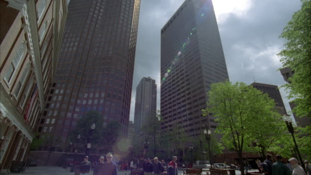up angle of downtown office area in boston. high rise buildings and pedestrians walking around courtyard. boston skylines. - courtyard stock videos & royalty-free footage