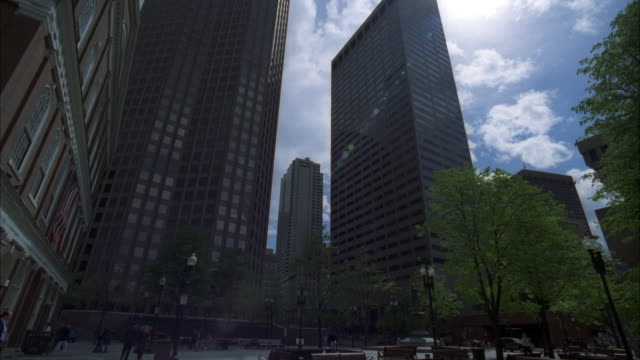 up angle of downtown office area in boston. high rise buildings and pedestrians walking around courtyard. boston skylines. - atrium grundstück stock-videos und b-roll-filmmaterial
