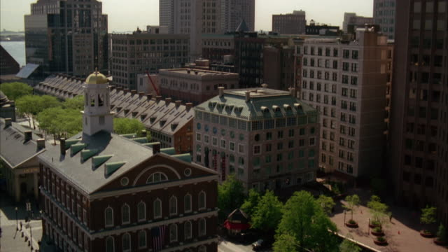 pan up from faneuil hall to custom house clock tower in downtown boston. cities. high rises and office buildings. - custom house tower stock videos & royalty-free footage