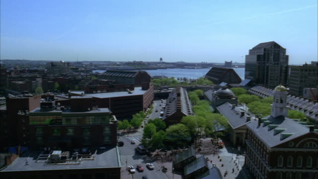 pan right to left across dock square in downtown boston. faneuil hall and custom house clock tower. charles river in bg. high rises and office buildings. freeways or highways visible. boston harbor. - custom house tower stock videos & royalty-free footage
