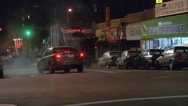 pan right to left of car in intersection getting hit by garbage truck. car accident, car crash. sunnyside, queens. restaurant on corner. - garbage truck stock videos & royalty-free footage