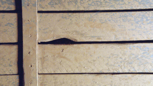 zoom in to crack in wood. could be wagon, cart, or wall. - cracked stock videos & royalty-free footage