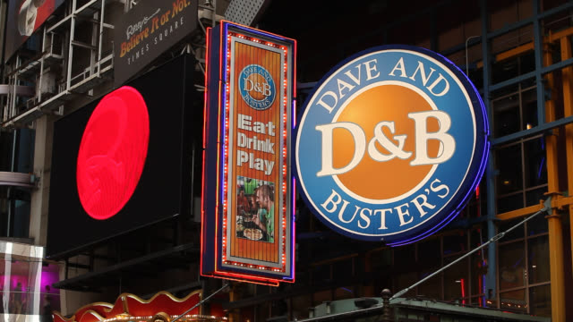 medium angle for dave and buster's restaurant sign in times square. - theatre district stock videos & royalty-free footage