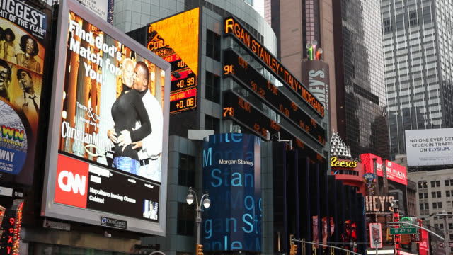 medium angle of signs, monitors or jumbotrons and advertisements in times square. landmarks. commercial areas. - theatre district stock videos & royalty-free footage