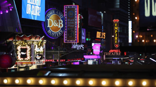 zoom in on signs, monitors or jumbotrons and advertisements in times square. landmarks. commercial areas. - large scale screen stock videos & royalty-free footage