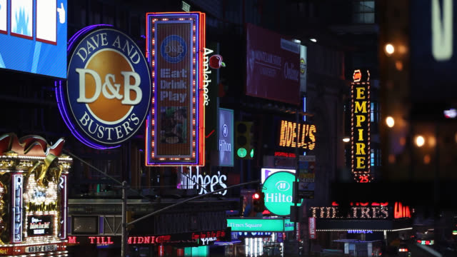 medium angle of signs, monitors or jumbotrons and advertisements in times square. landmarks. commercial areas. - large scale screen stock videos & royalty-free footage