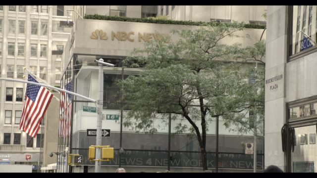 pan right to left of nbc news offices, rockefeller center. - rockefeller center video stock e b–roll