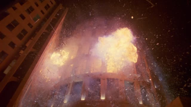 wide angle of explosion at vancouver public library. fire, flames, smoke. debris flying. broken glass windows. car alarms. could be laboratory, college or university building, or high rise office building. playback. 5.1 surround sound. 2794-012. - bombing stock videos & royalty-free footage