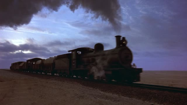 zoom in on steam engine train on railroad tracks through desert. sand. playback. 5.1 stereo surround sound. 2874-03. - 1914 stock videos & royalty-free footage
